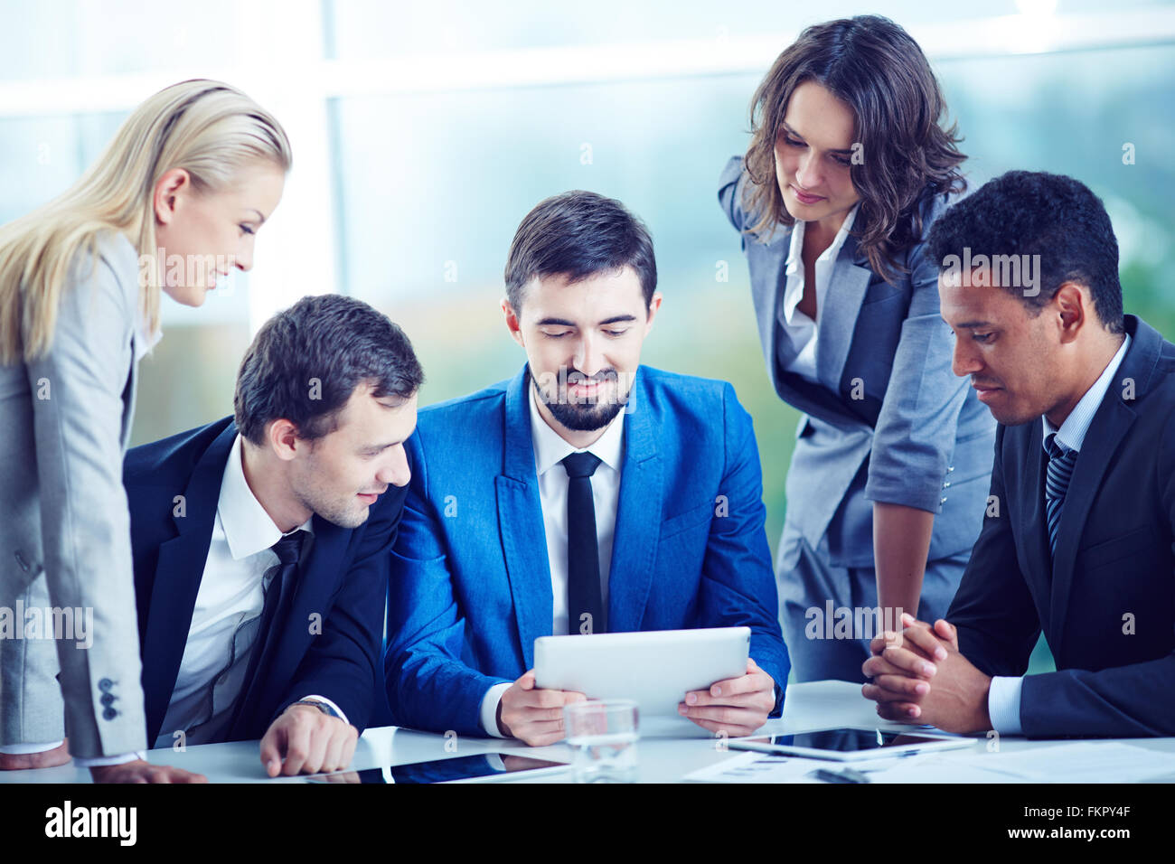 Group of business people working together - Stock Image
