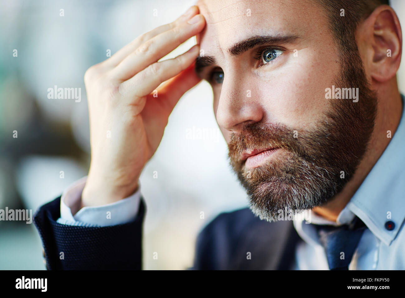 Bearded businessman contemplating about something - Stock Image