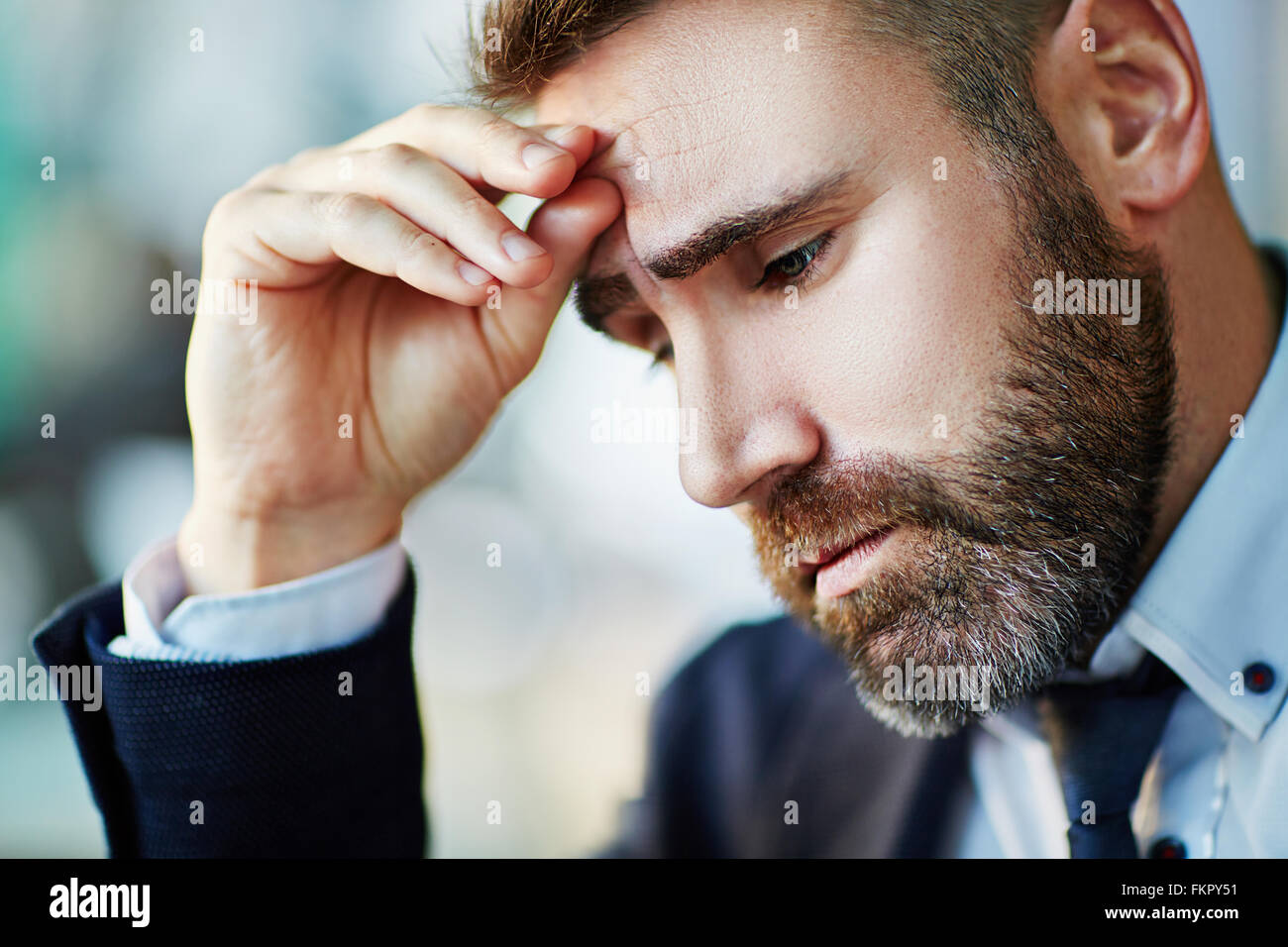 Portrait of businessman worried about something - Stock Image