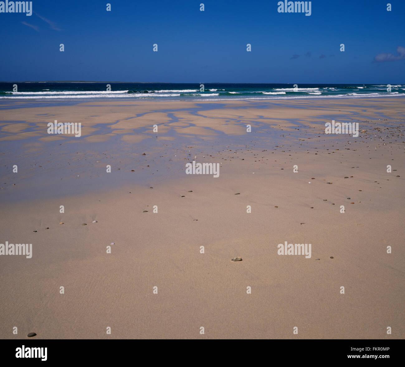 Sandy beach, blue sky, Belmullet, Co Mayo, West Coast of Ireland, Ireland - Stock Image