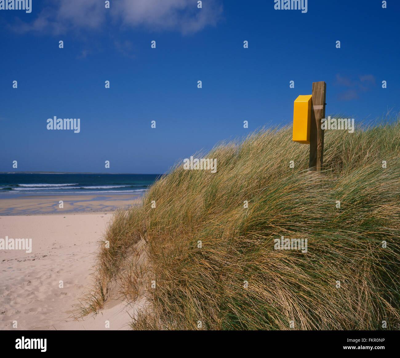 Life buoy on sandy beach, Belmullet, Co Mayo, West Coast of Ireland, Ireland - Stock Image