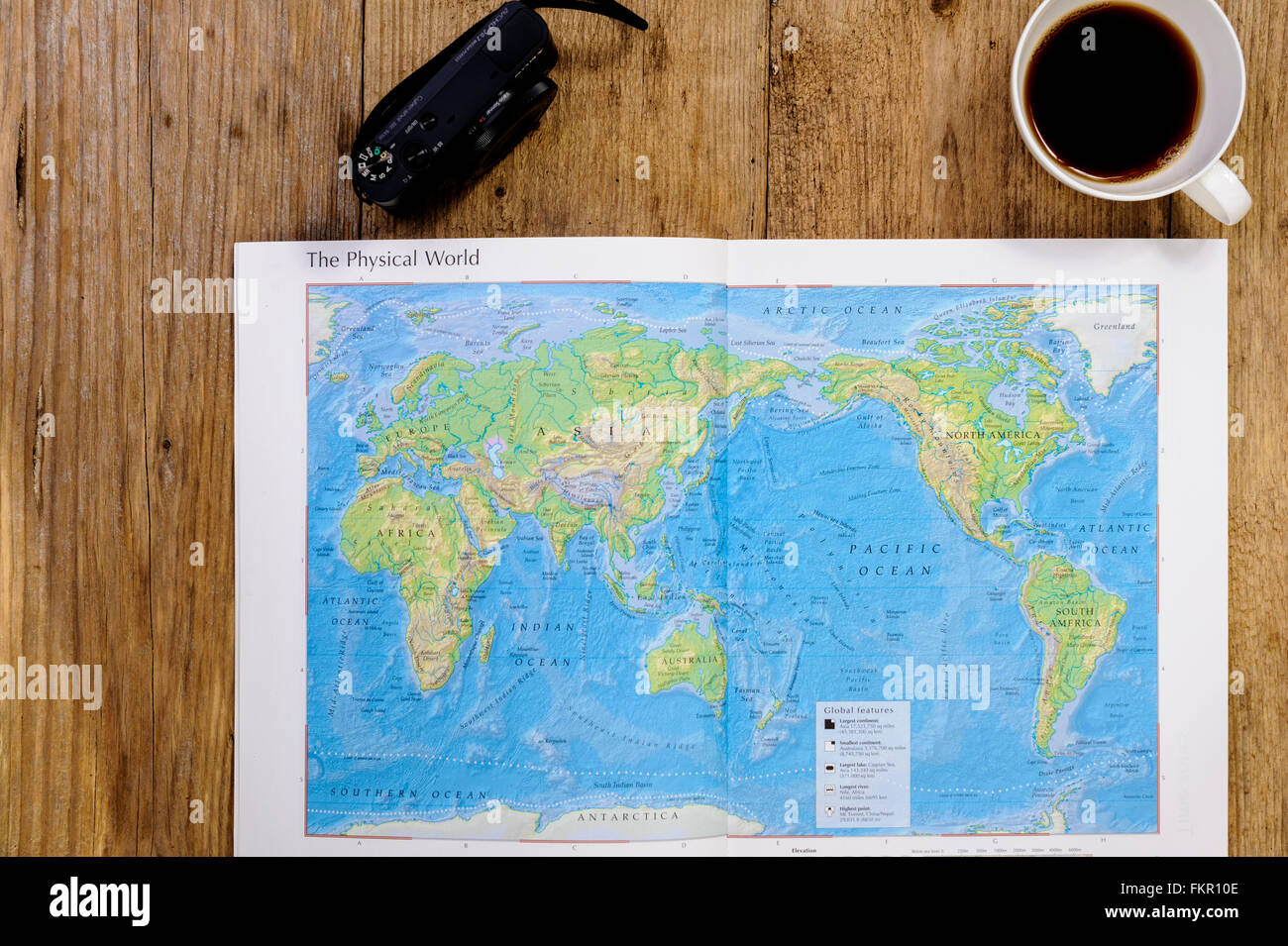 Planning a holiday, with world map. - Stock Image
