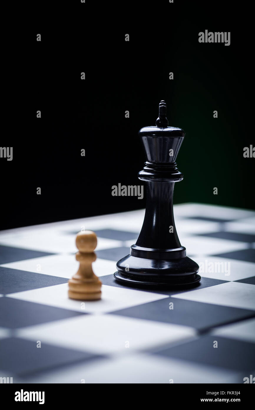 Close-up image of a chess board with chess pieces. - Stock Image