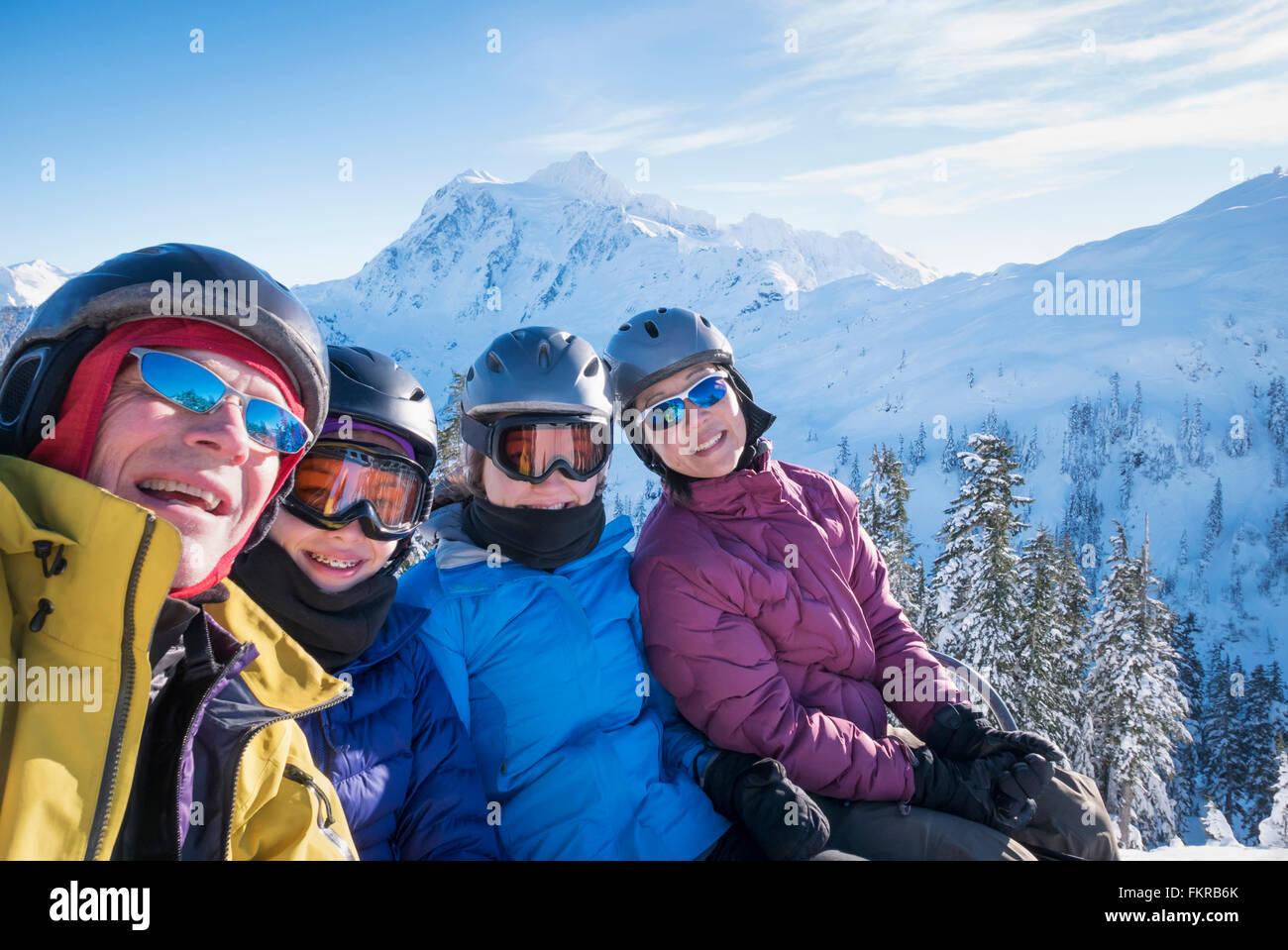 Family riding ski lift Stock Photo