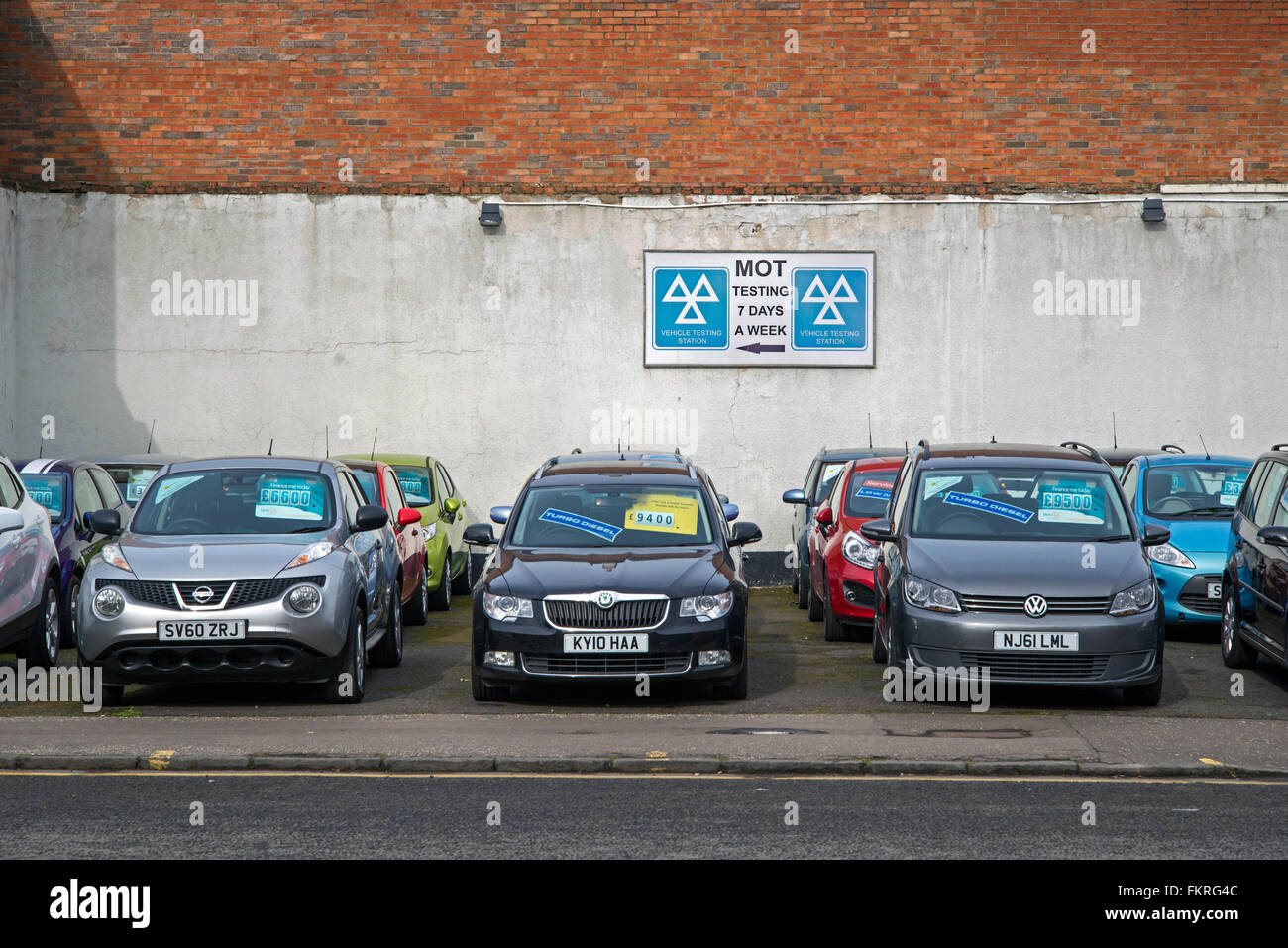 Secondhand cars for sale at a motor dealers and MOT centre in Edinburgh. - Stock Image