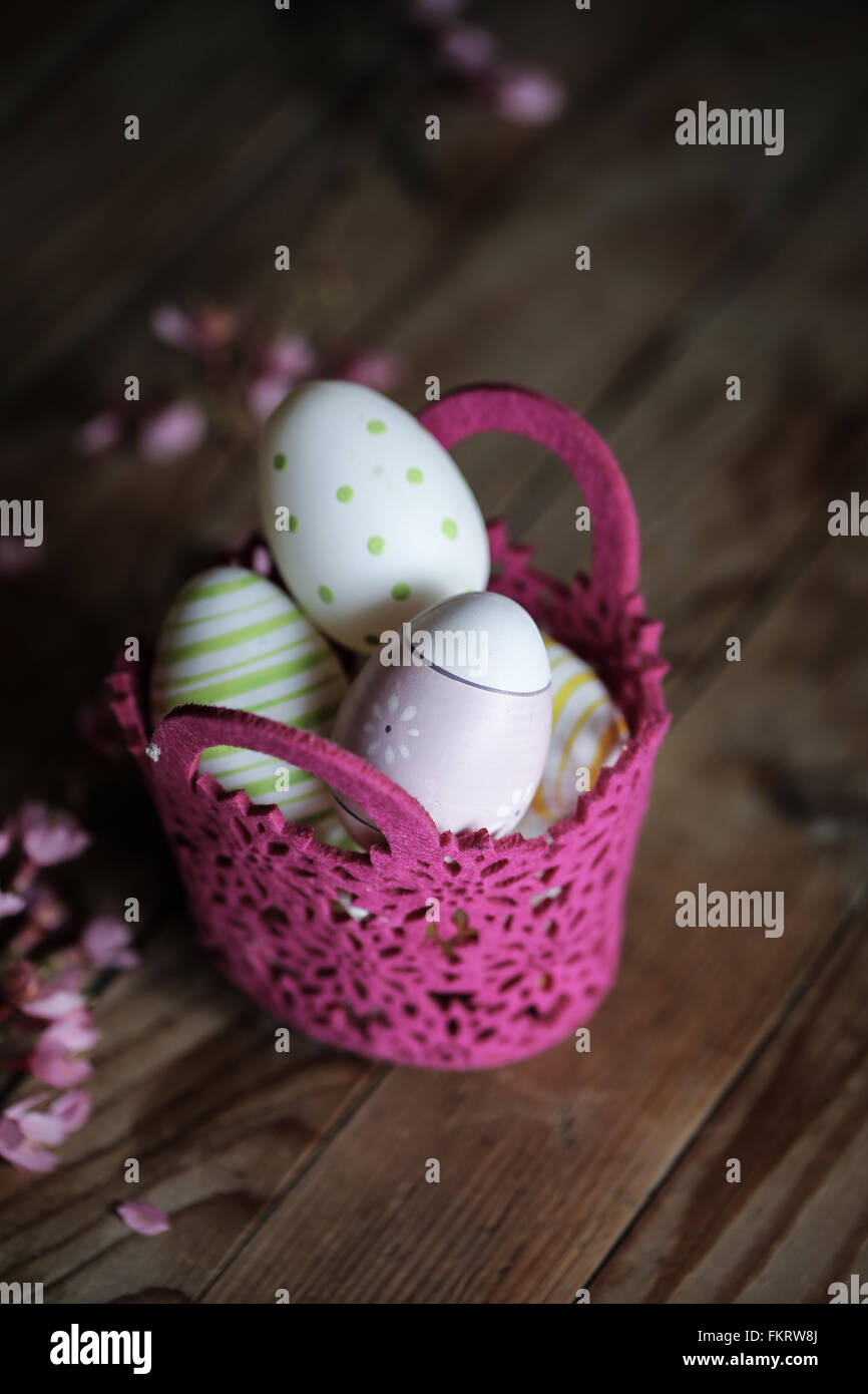 Decorated egg in a basket - Stock Image