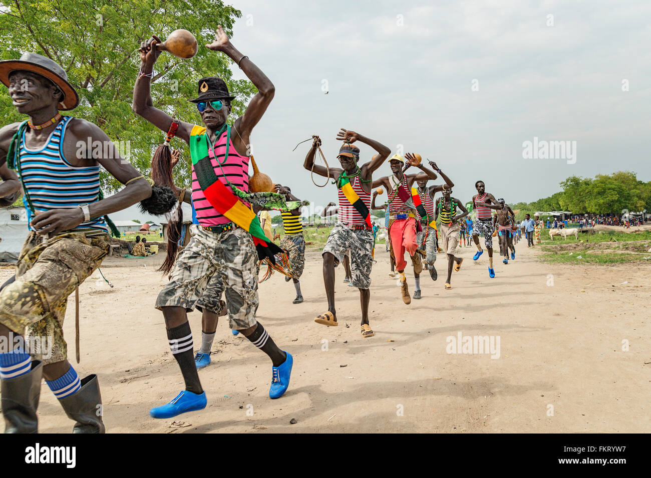 Murle men having a party in Pibor, South Sudan. - Stock Image