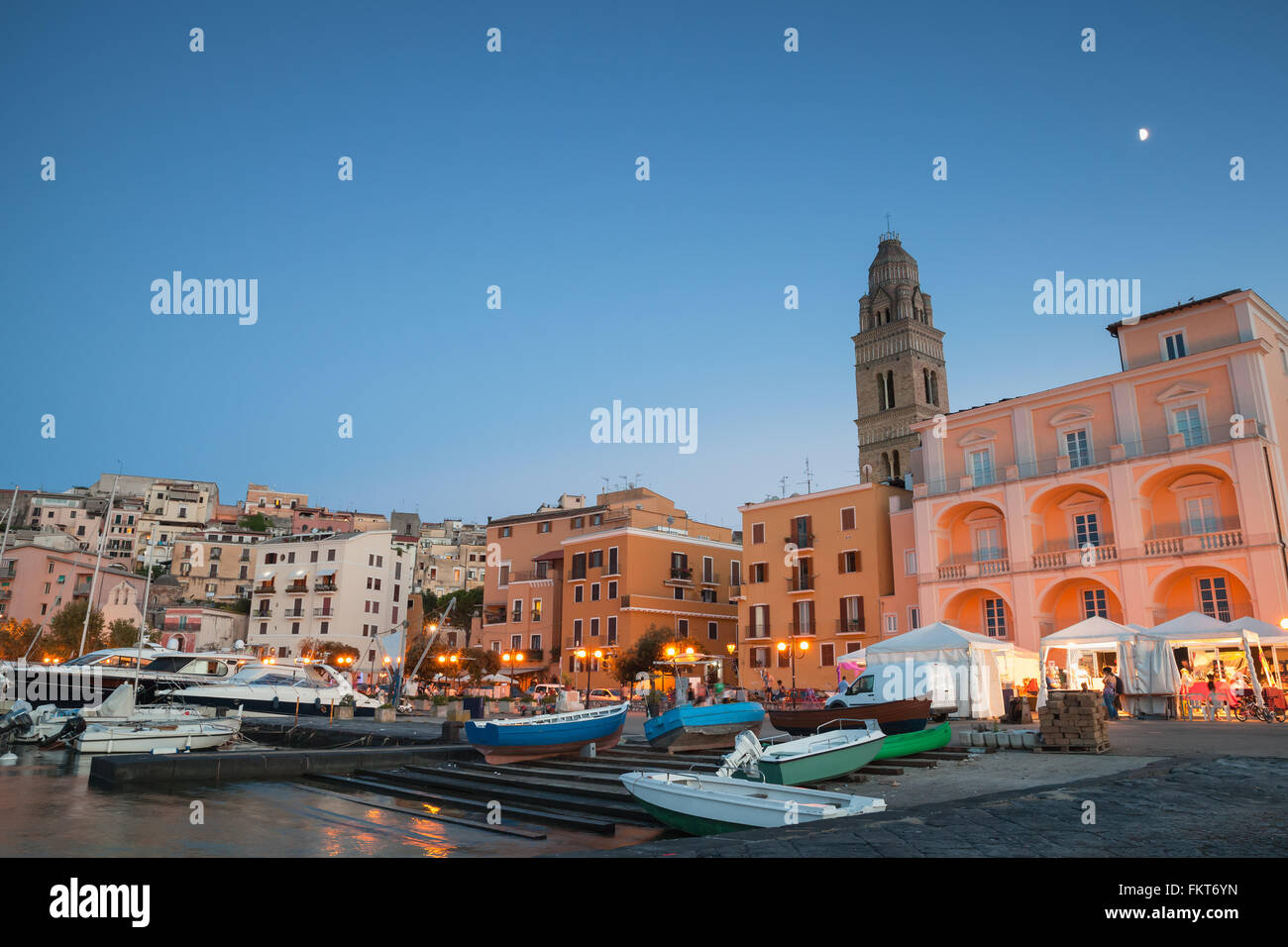 Port with moored boats and pleasure yachts. Night cityscape of Gaeta town, Italy - Stock Image