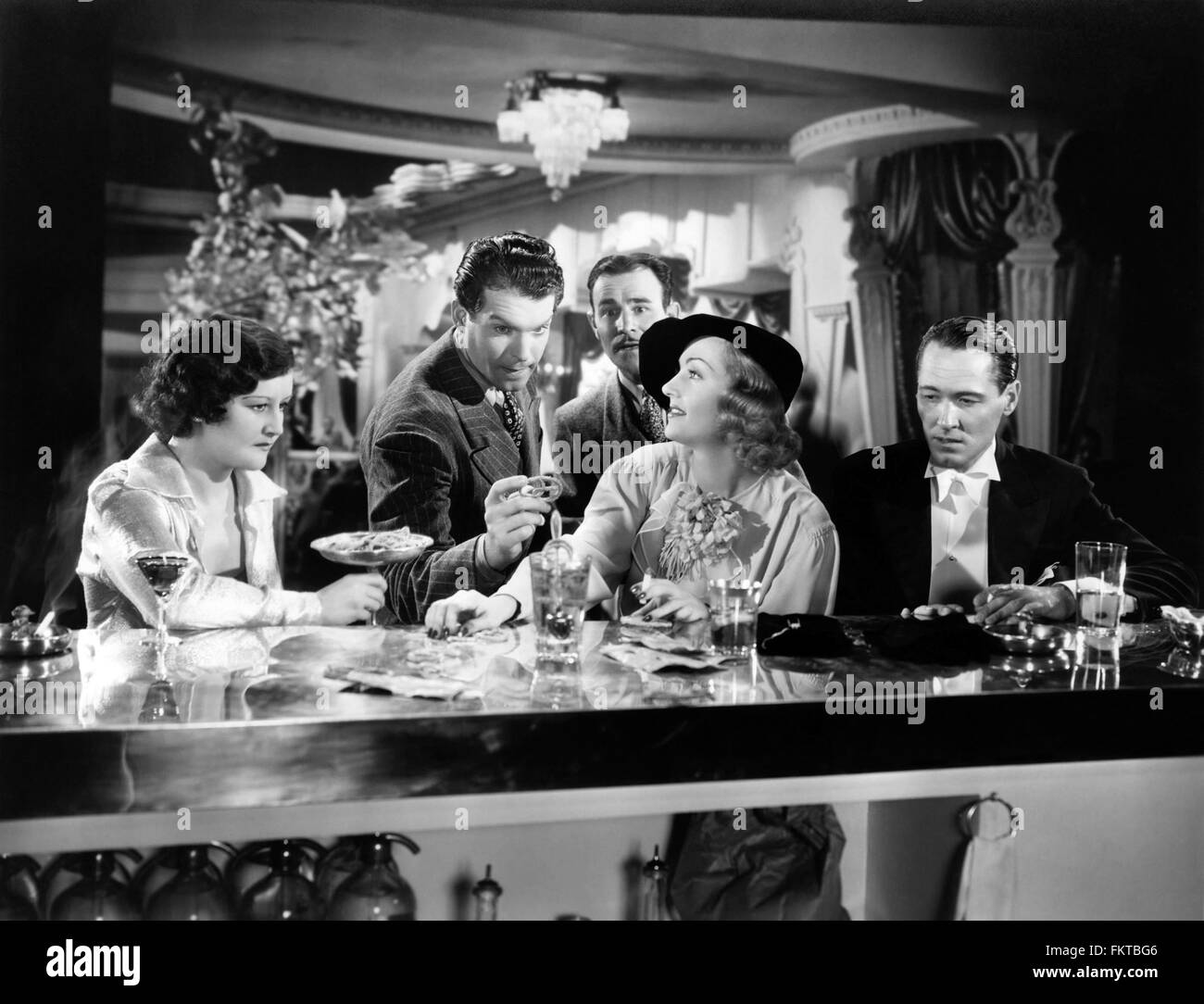 Portrait of MacMurray Fred in Hands Across the Table - Stock Image