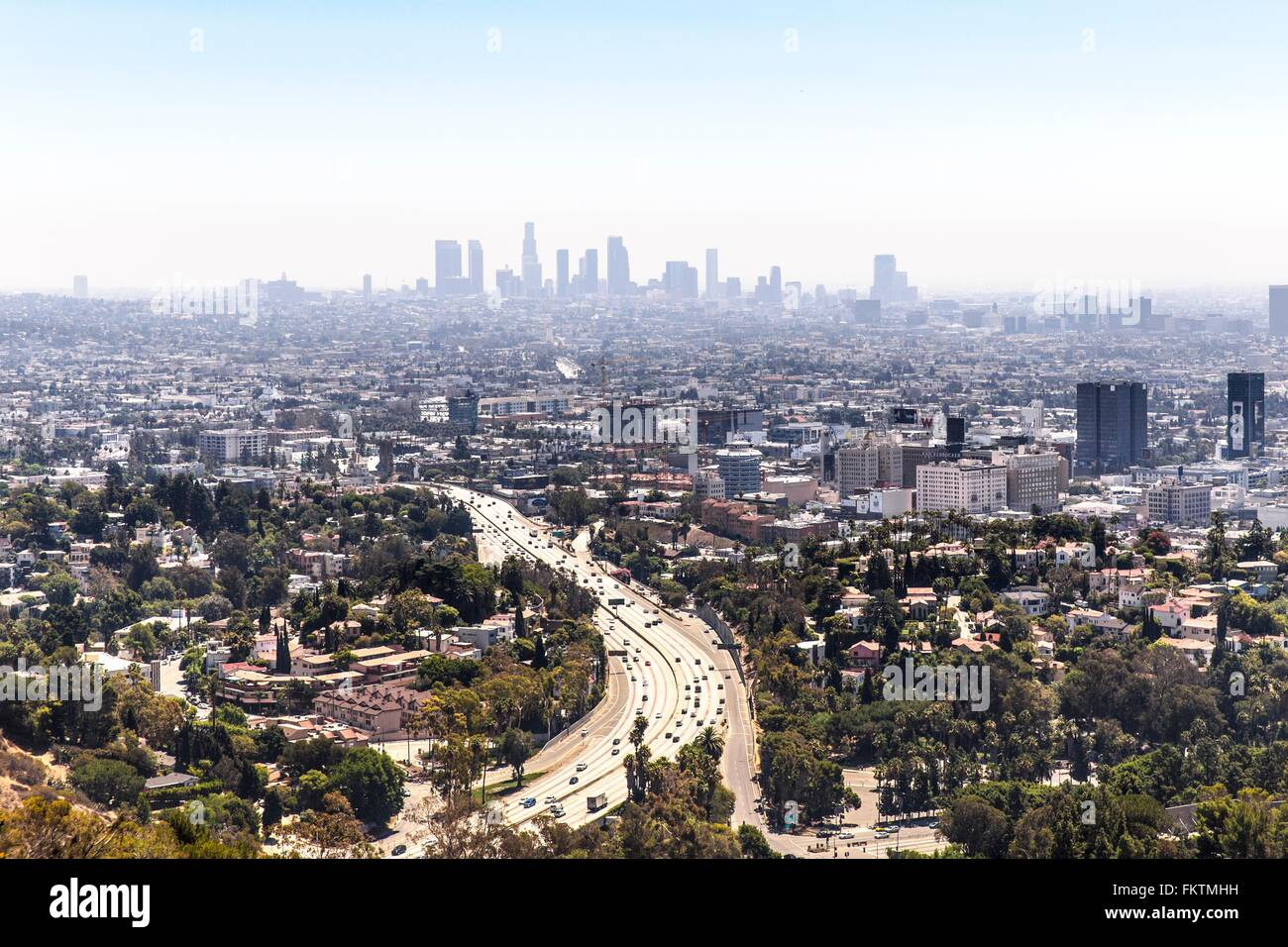 Elevated view of highway curving through urban sprawl, Los Angeles, California, USA - Stock Image