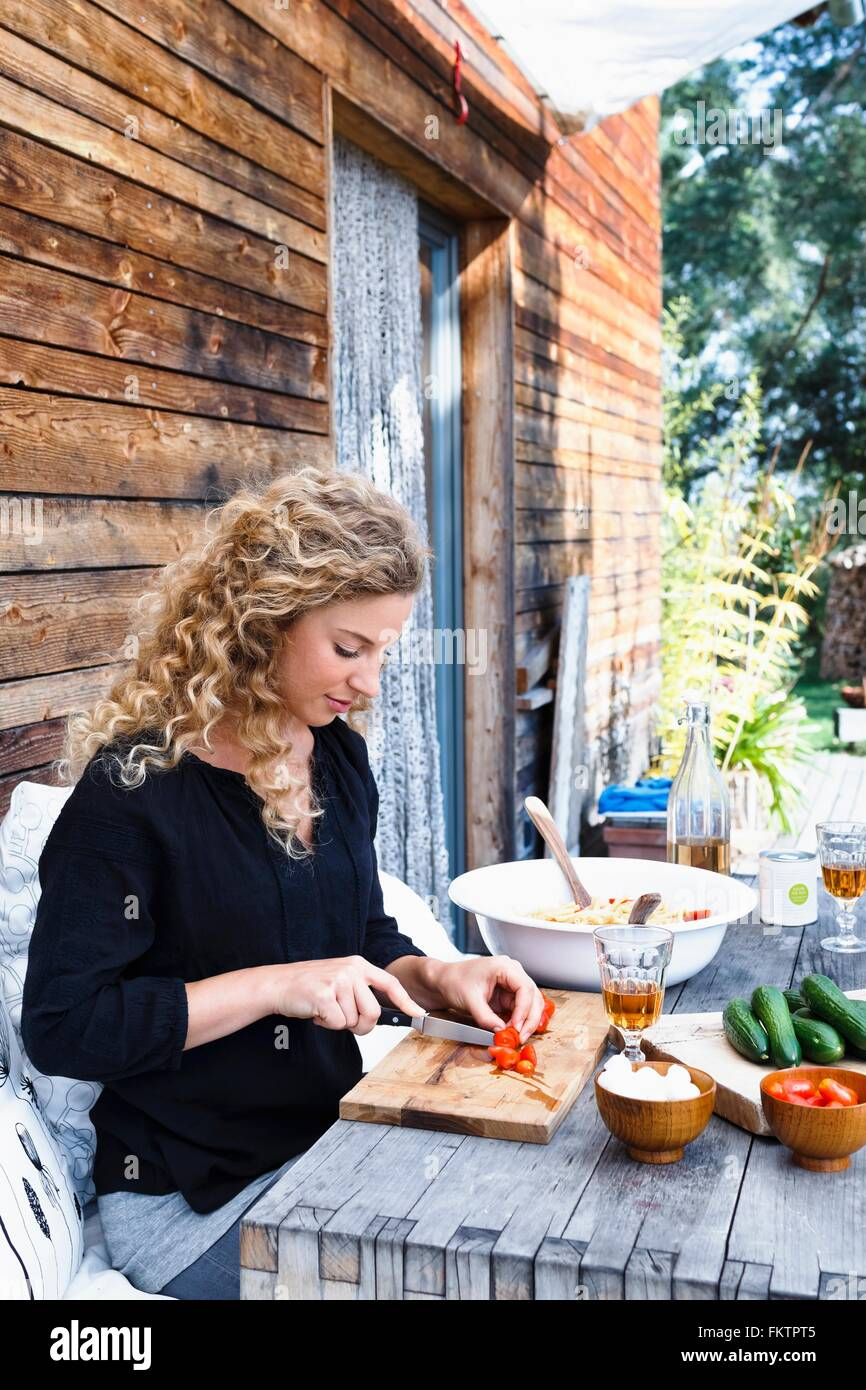 Woman preparing lunch al fresco - Stock Image