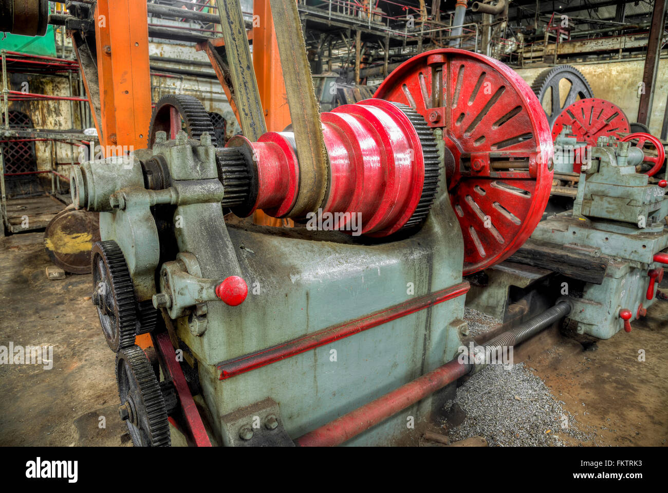 Old lathe driven by belt transmission with different  gearing shaft in Gondang Baru sugar factory, Indonesia - Stock Image