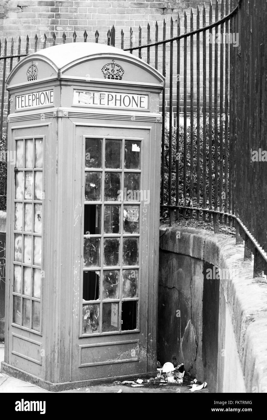 Vandalised telephone box, Central London, UK - Stock Image