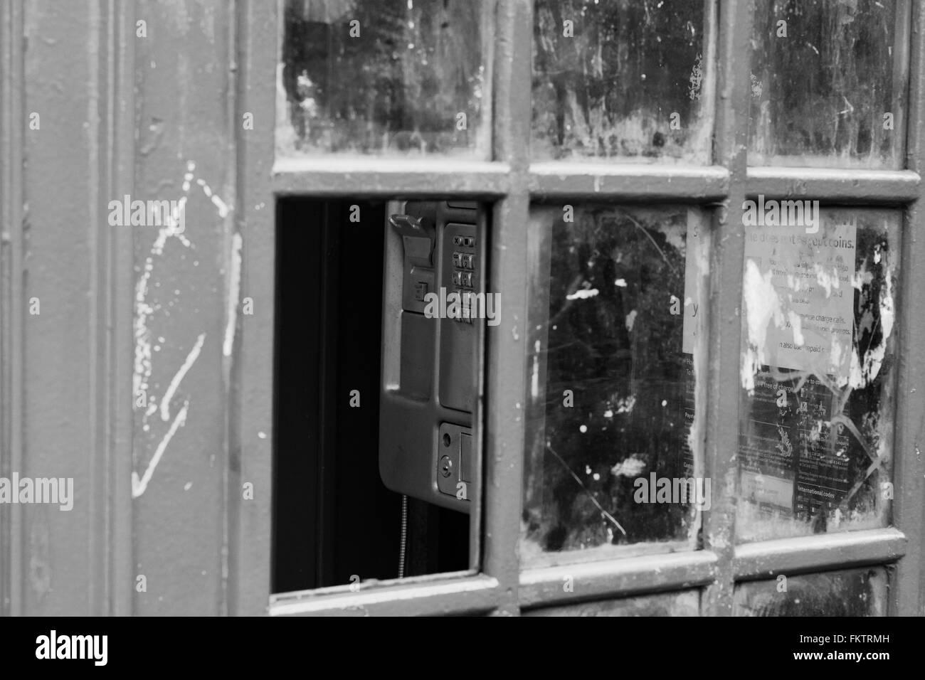 Vandalised telephone box, London, UK - Stock Image