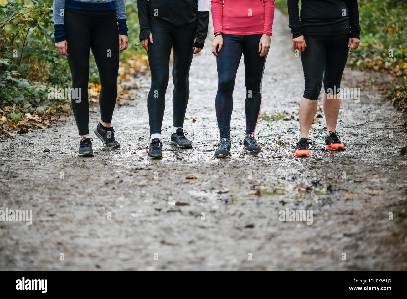 Waist down of teenage girl and women runners preparing to run in park Stock Photo