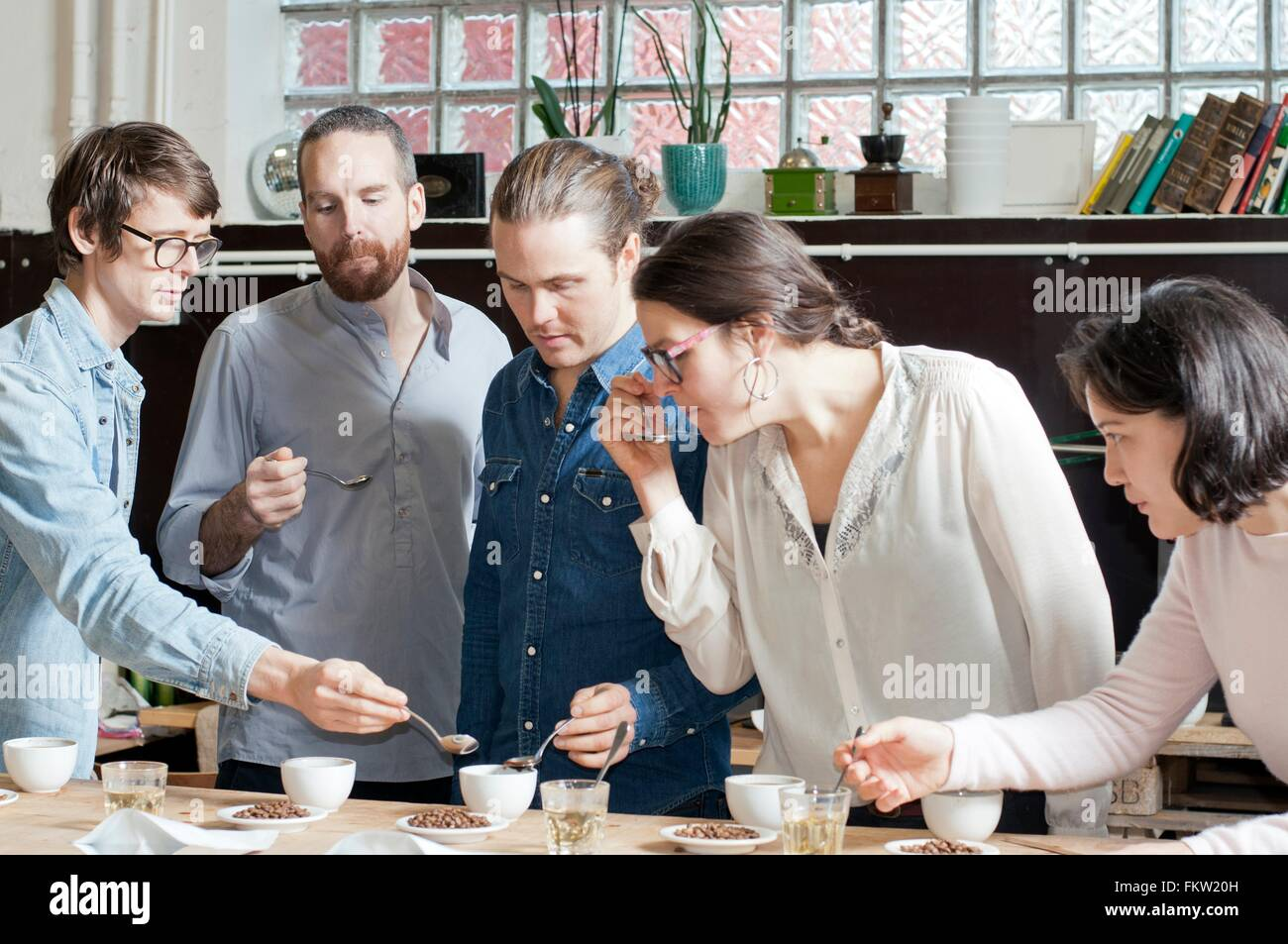 C fee tasters sipping c fee with spoon Stock Photo