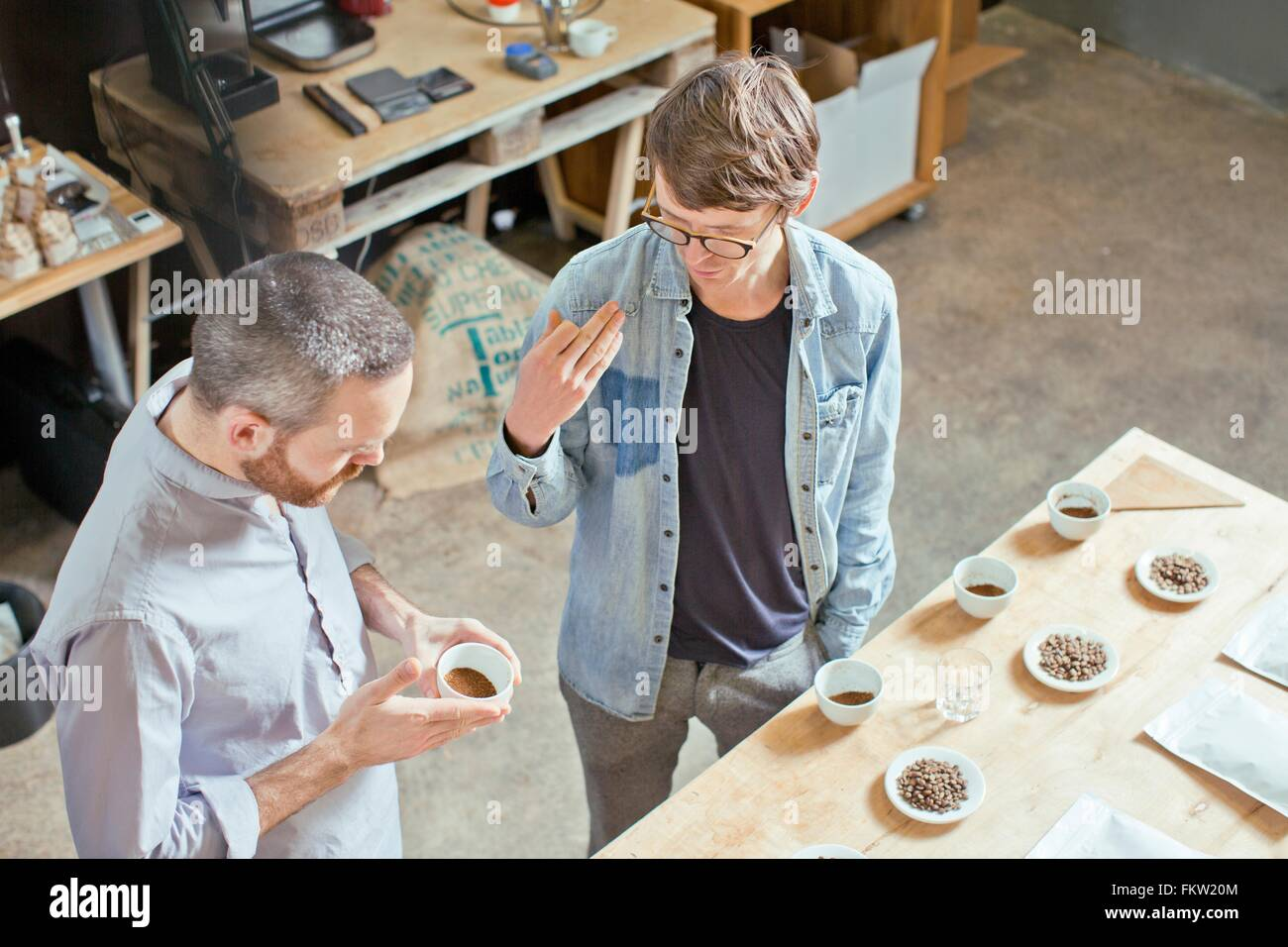 C fee business owner and customer discussing c fee - Stock Image