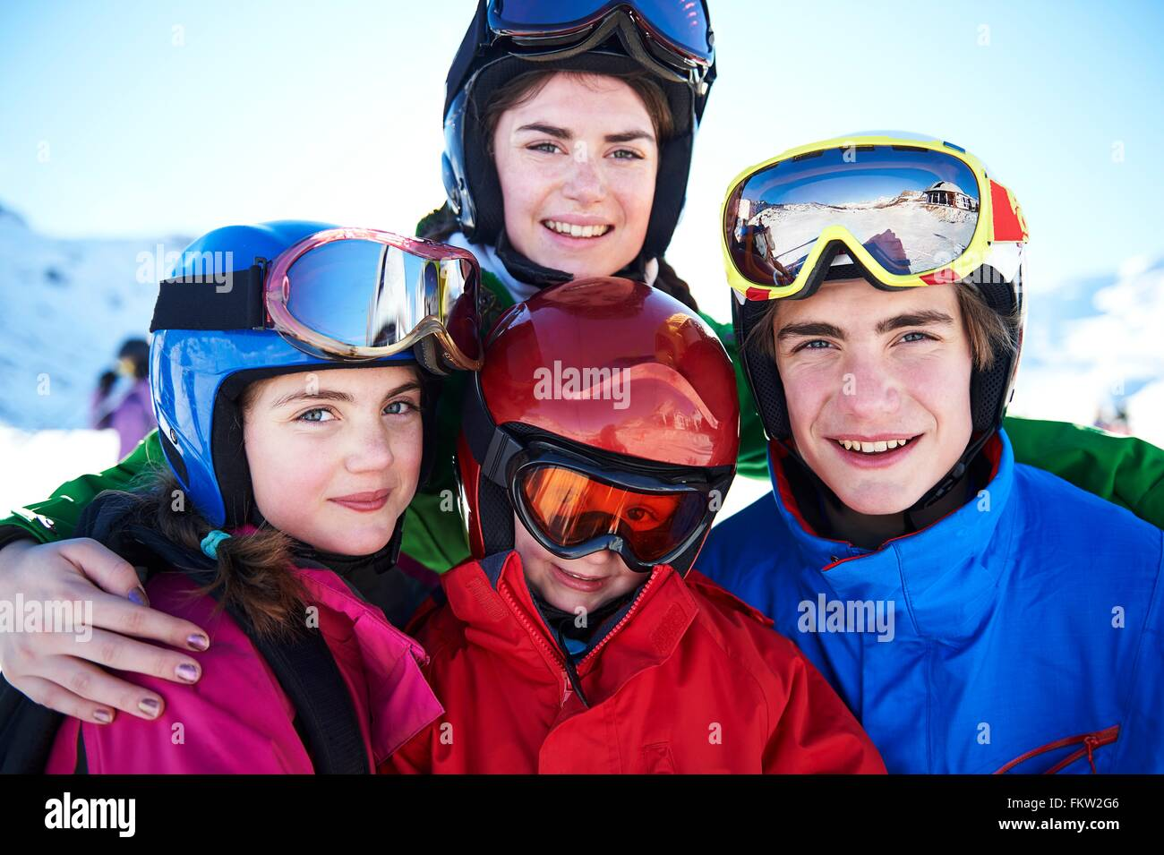 Sisters and brothers on skiing holiday - Stock Image