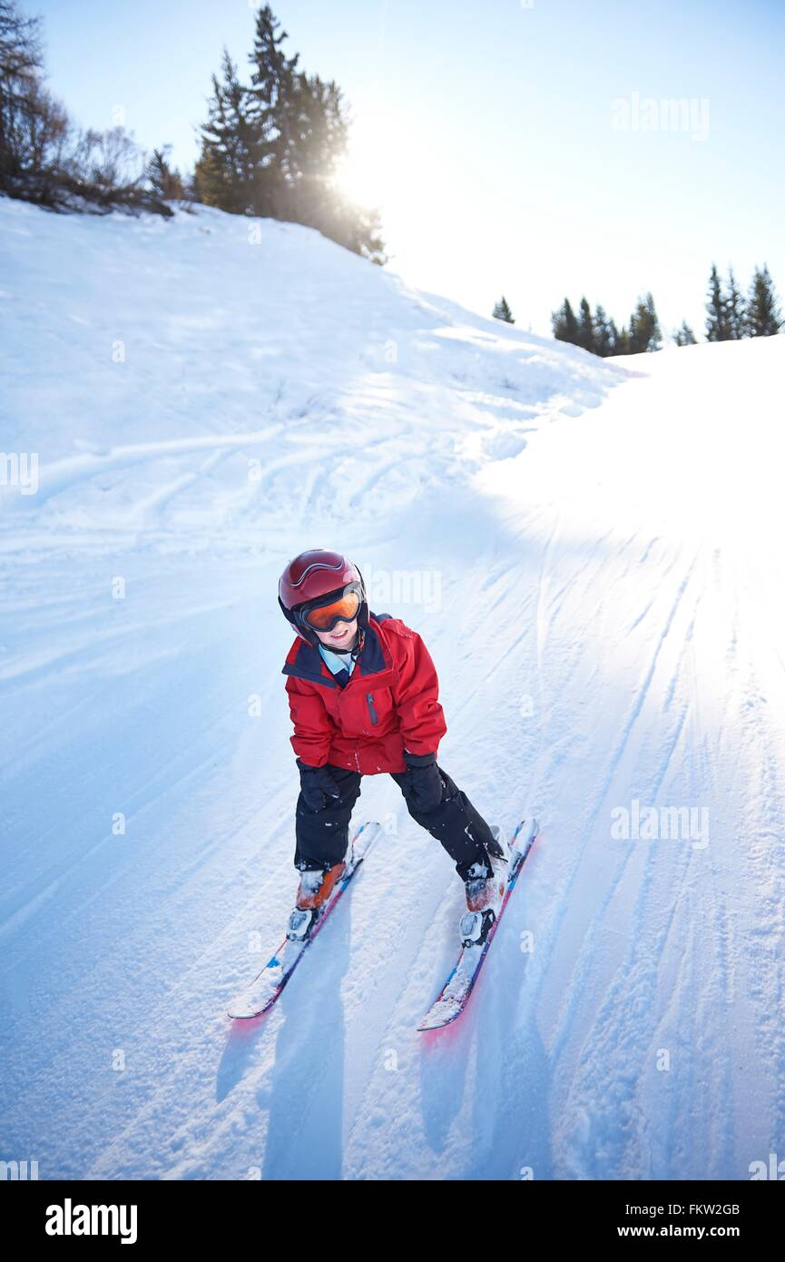 Young skier going downhill - Stock Image