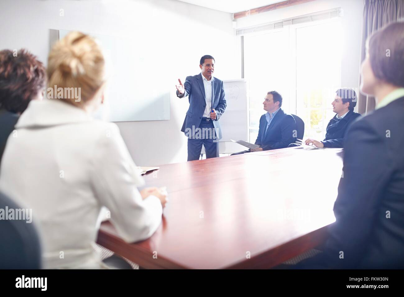Colleagues in conference room watching presentation - Stock Image