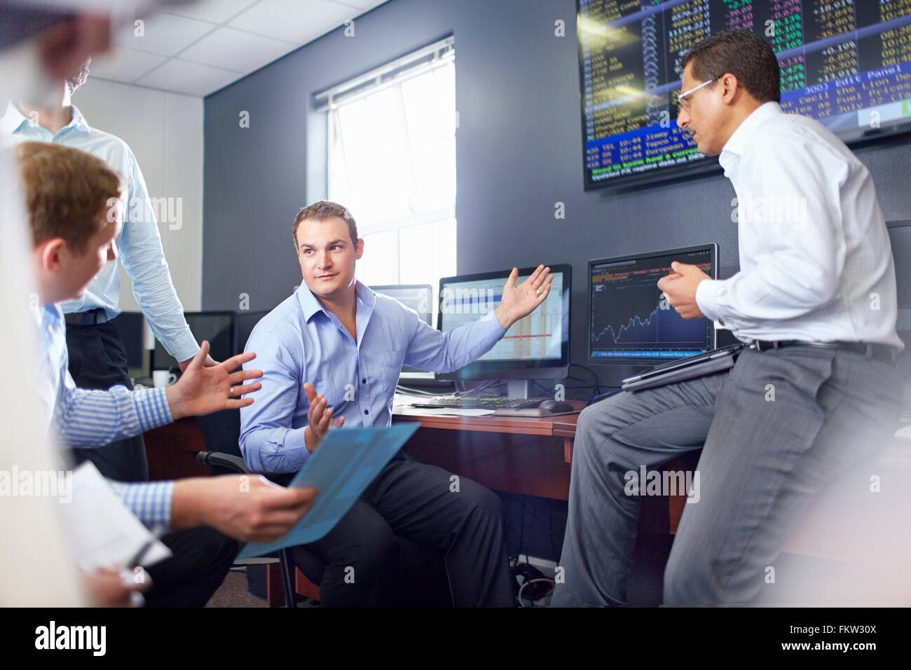 Colleagues in office having discussion, hand gestures - Stock Image