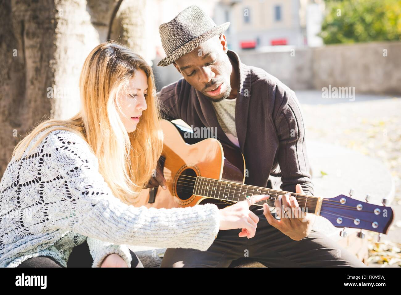 learning to play guitar stock photos learning to play guitar stock images alamy. Black Bedroom Furniture Sets. Home Design Ideas