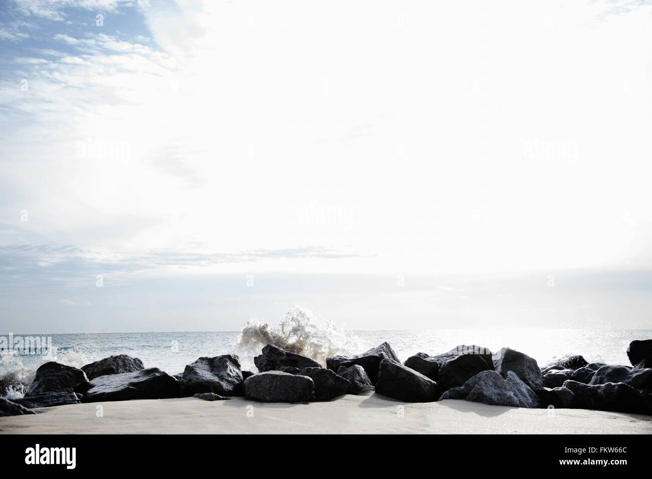 Rocks acting as breakers on Palm Beach, Florida, USA - Stock Image