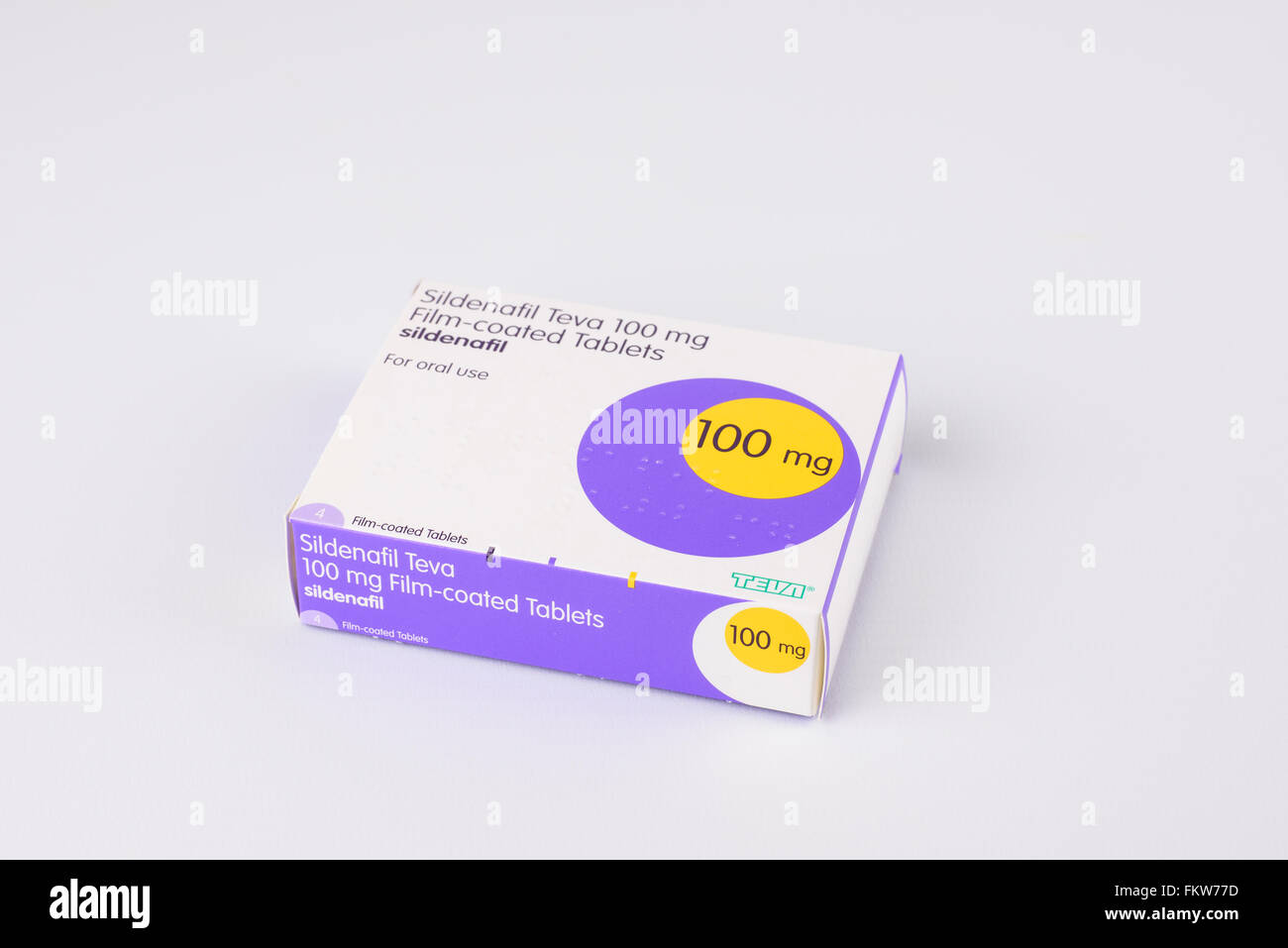 Packet of 100mg Sildenafil (generic Viagra) capsules against a white background - Stock Image