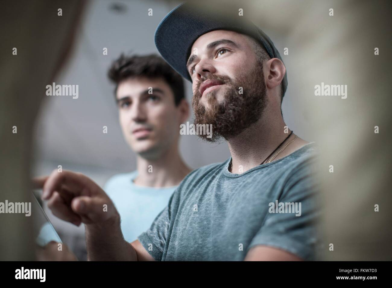 Two young men at office reception - Stock Image