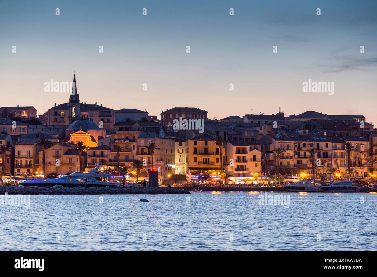 View   sea and Calvi city lights at dusk, Corsica, France - Stock Image