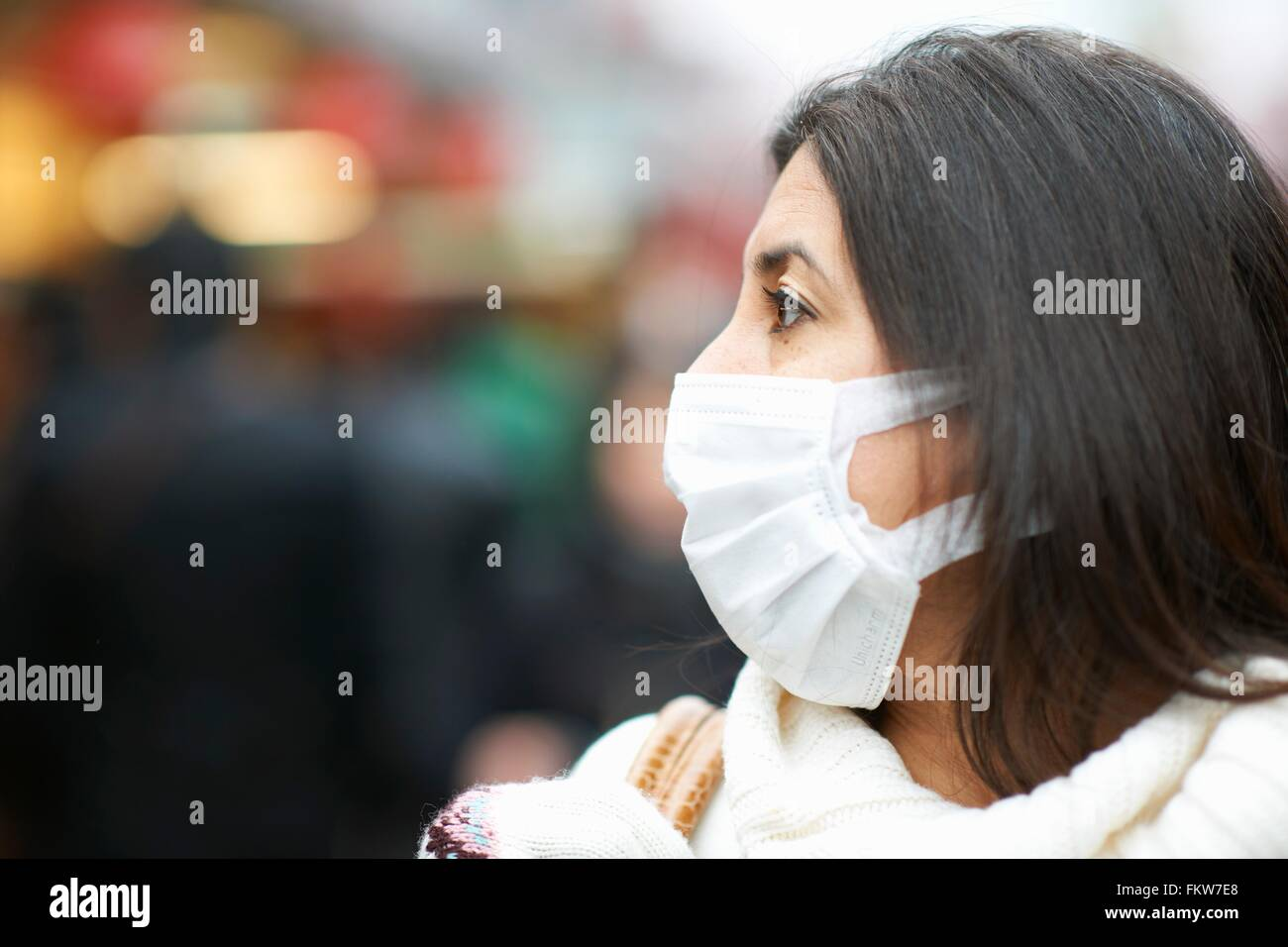 Close up of mature woman wearing pollution mask, Tokyo, Japan - Stock Image