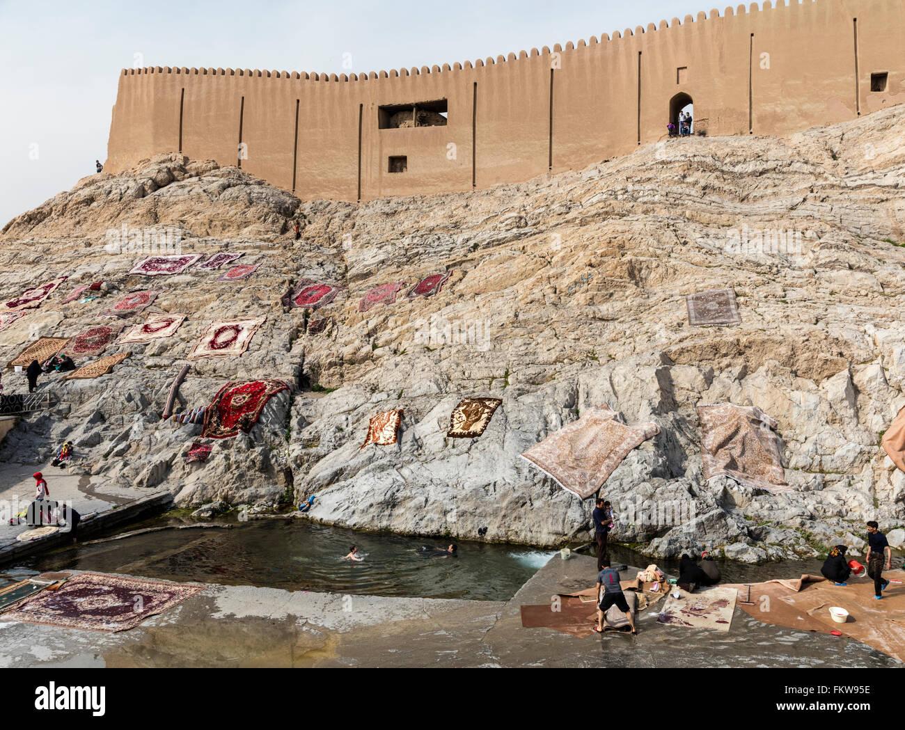 Traditional carpet washing at the Cheshmeh Ali spring at Rayy in southern Tehran. Qajar era citadel & drying - Stock Image