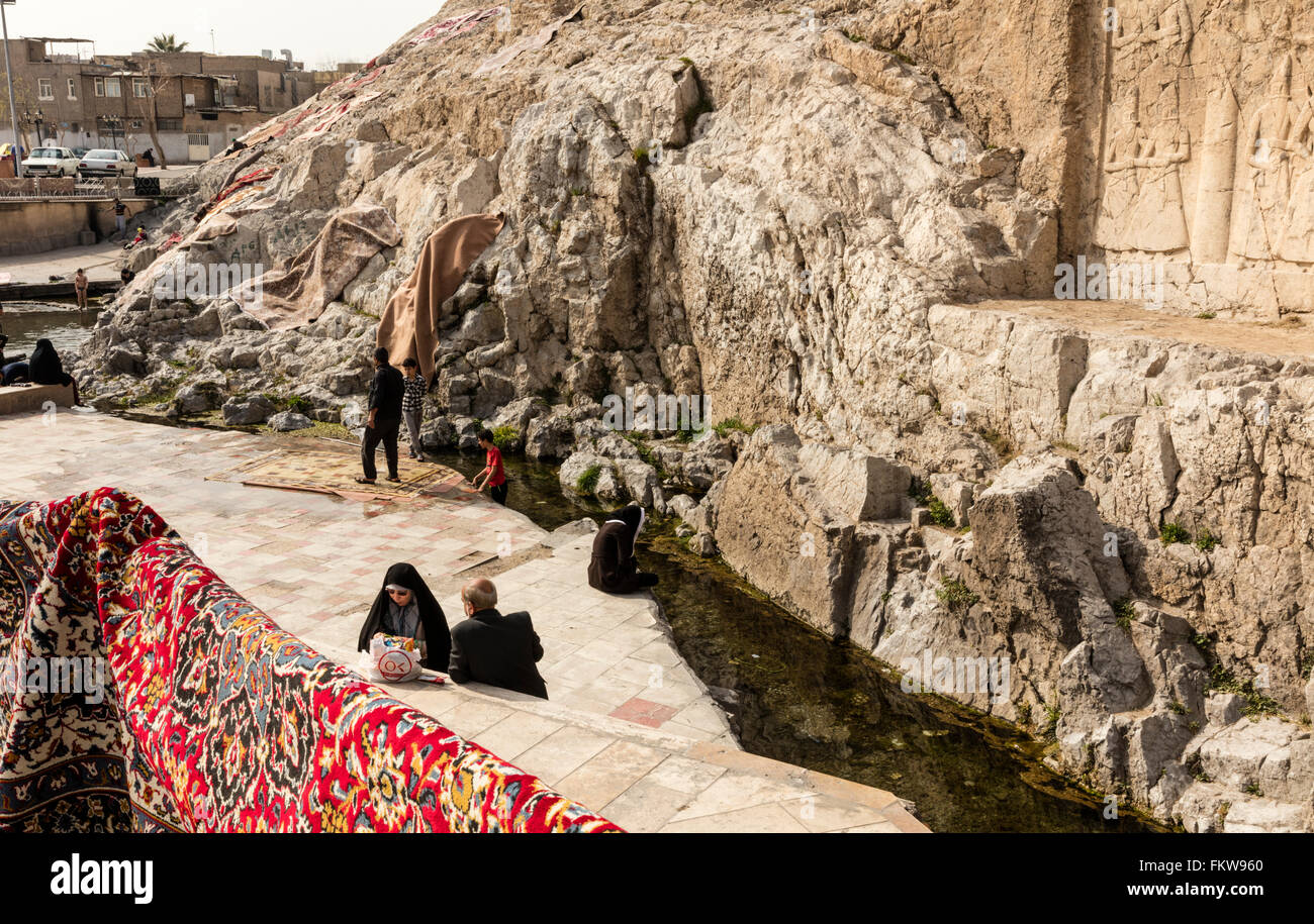 Traditional carpet washing at the Cheshmeh Ali spring at Rayy in southern Tehran. Qajar era high relief visible - Stock Image