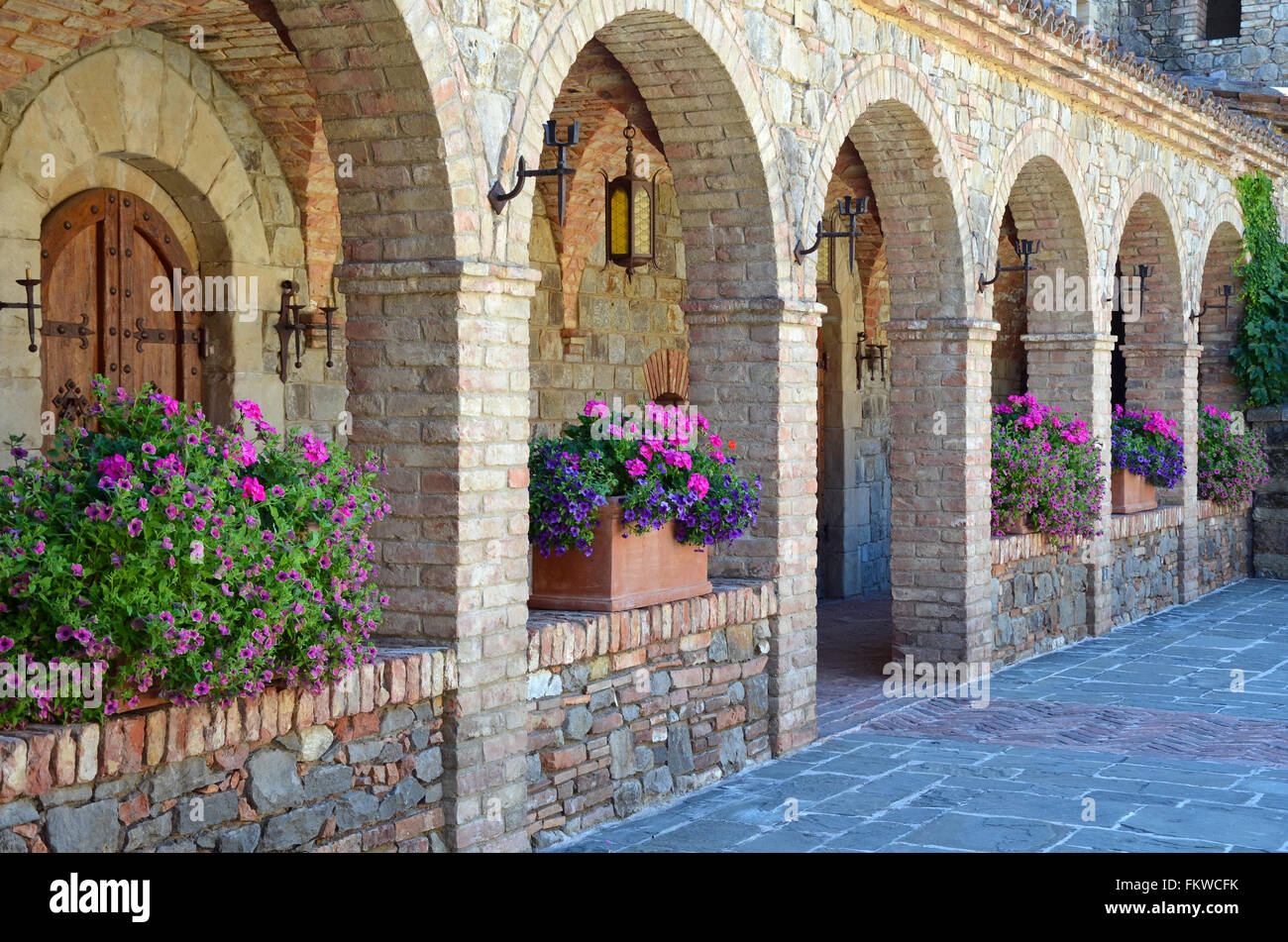 Medieval style brick archway and courtyard - Stock Image