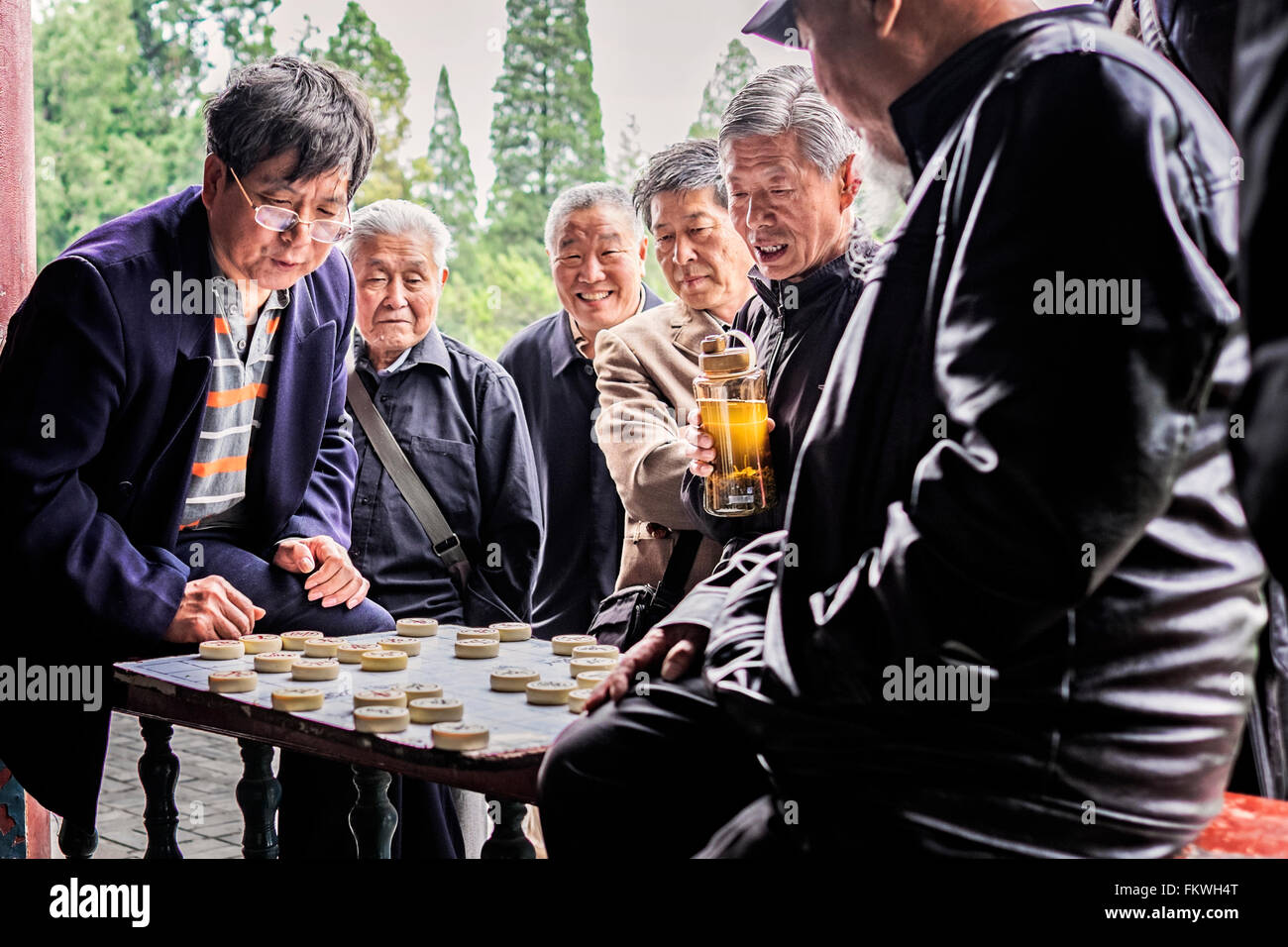 Locals playing Chinese checkers at the Temple of Heaven in Beijing, China Stock Photo