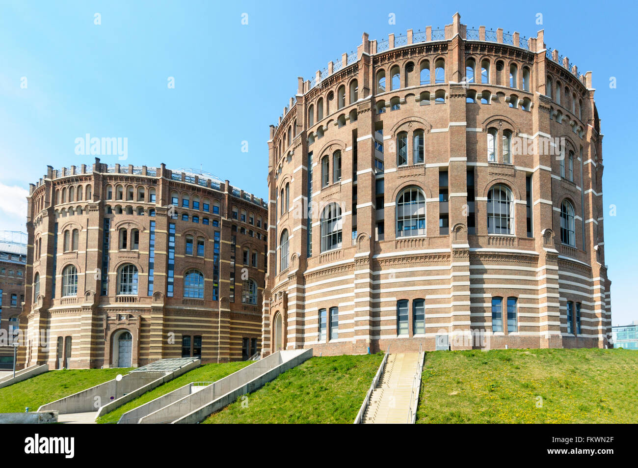 The gasometers of the former Vienna municipal gas works Gaswerk Simmering in  Vienna - Stock Image
