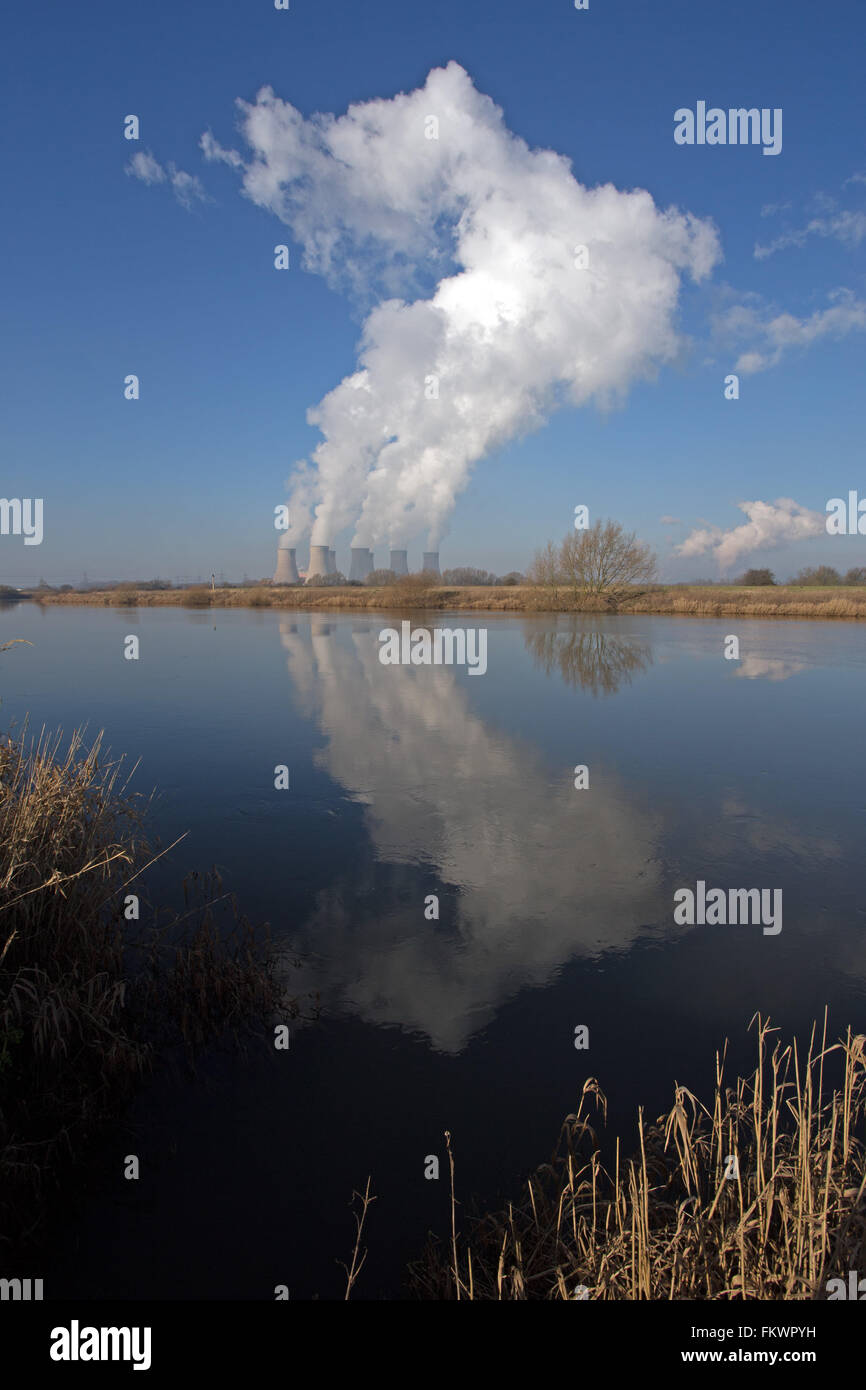 Cloud developing over Cottam Power Station in Nottinghamshire is reflected in the waters of the river Trent near - Stock Image