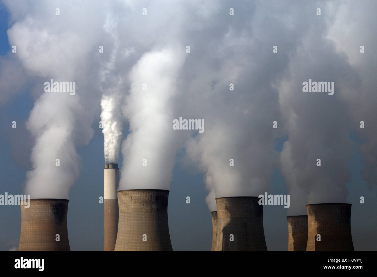 Clouds of steam rising from the cooling towers and chimney of Cottam Power Station in Nottinghamshire. - Stock Image