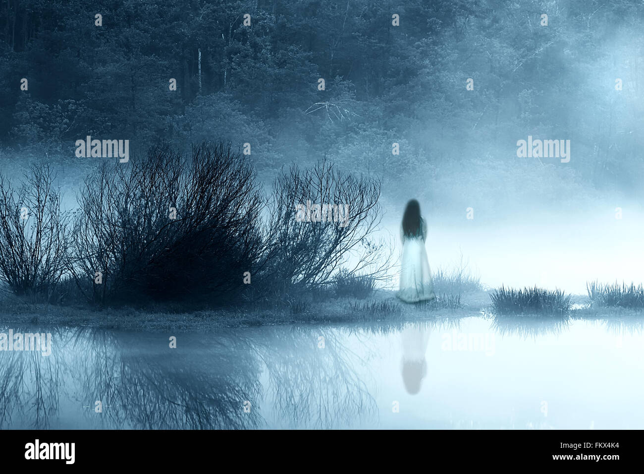 Mysterious Woman in the Mist - Stock Image