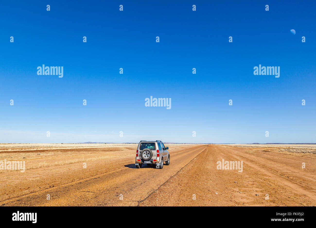 Diamantina Developmental Road through the endless expanses of the Channel Country, Barcoo Shire, Central West Queensland - Stock Image