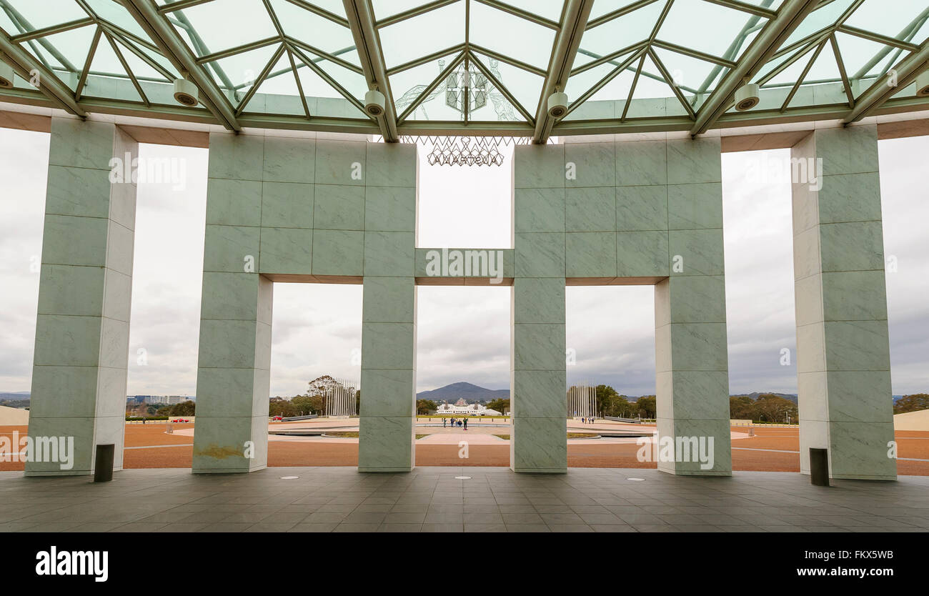 The entrance area to Australia's Parliament House, Capital Hill, Canberra, with the Australian War Memorial in the - Stock Image