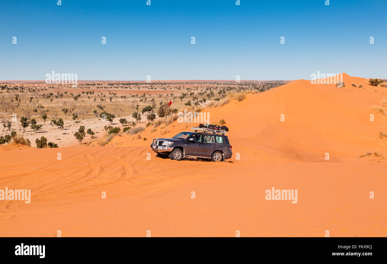 a 4WD enthusiast reaching the crest of the 'Big Red' dune after crossing the Simpson Desert. - Stock Image