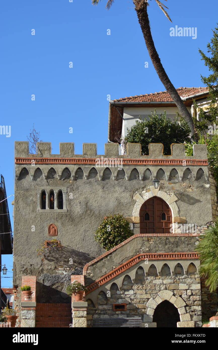 A old Typical House in Italy with a Palm tree - Stock Image