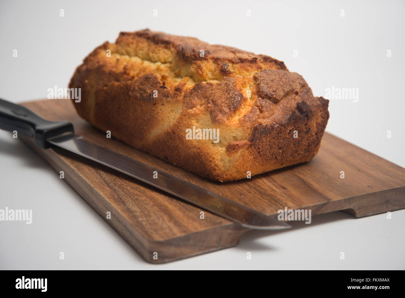 Homemade Madeira sponge cake on a wooden board - Stock Image
