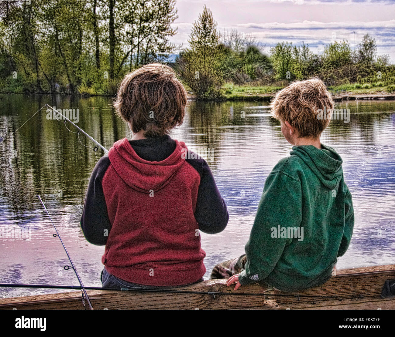 Two young boys fishing by the side of a lake, digitally enhanced as an illustration. - Stock Image
