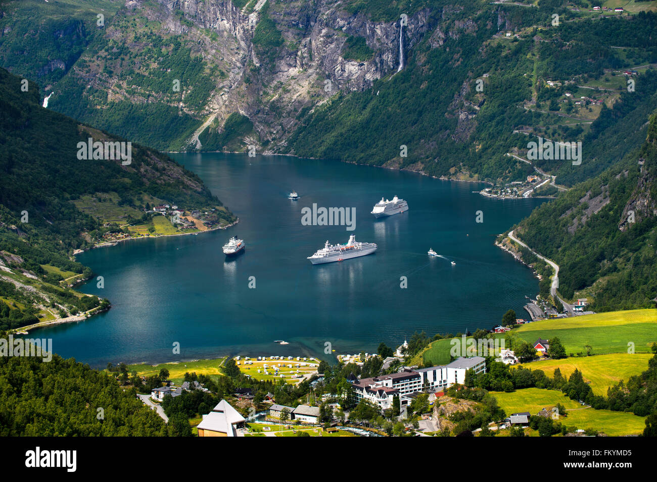 View from the Flydalsjuvet lookout on three cruise ships in the Geirangerfjord, Geiranger, Møre og Romsdal, - Stock Image
