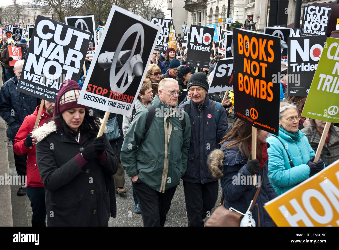 CND demo with posters 'Books not Bombs' 'Stop Trident 'Cut War not Welfare'. London 2016 - Stock Image