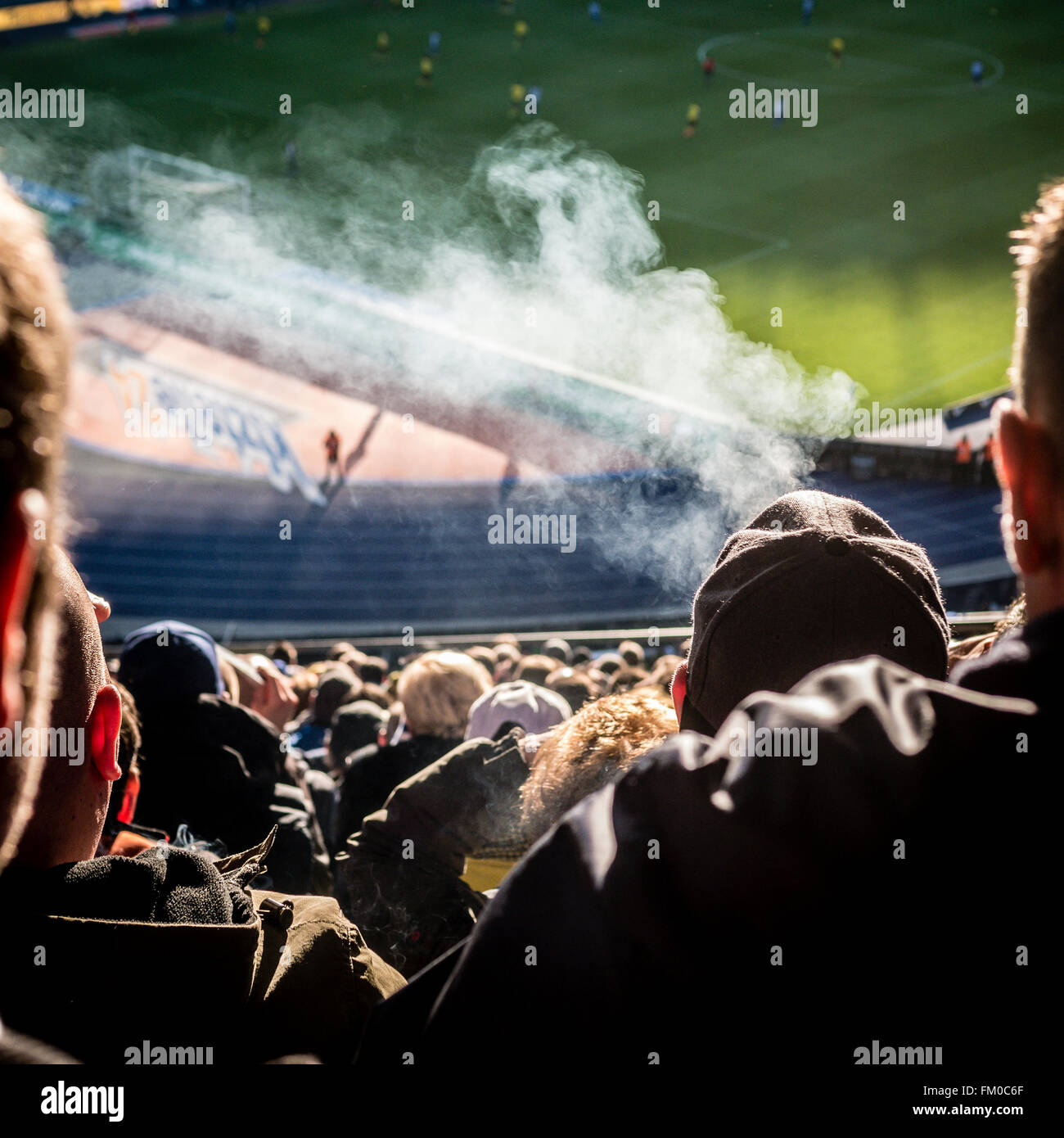 Football Fans Smoking inside the Olympiastadion Berlin, Germany - Feb 2016 - Stock Image