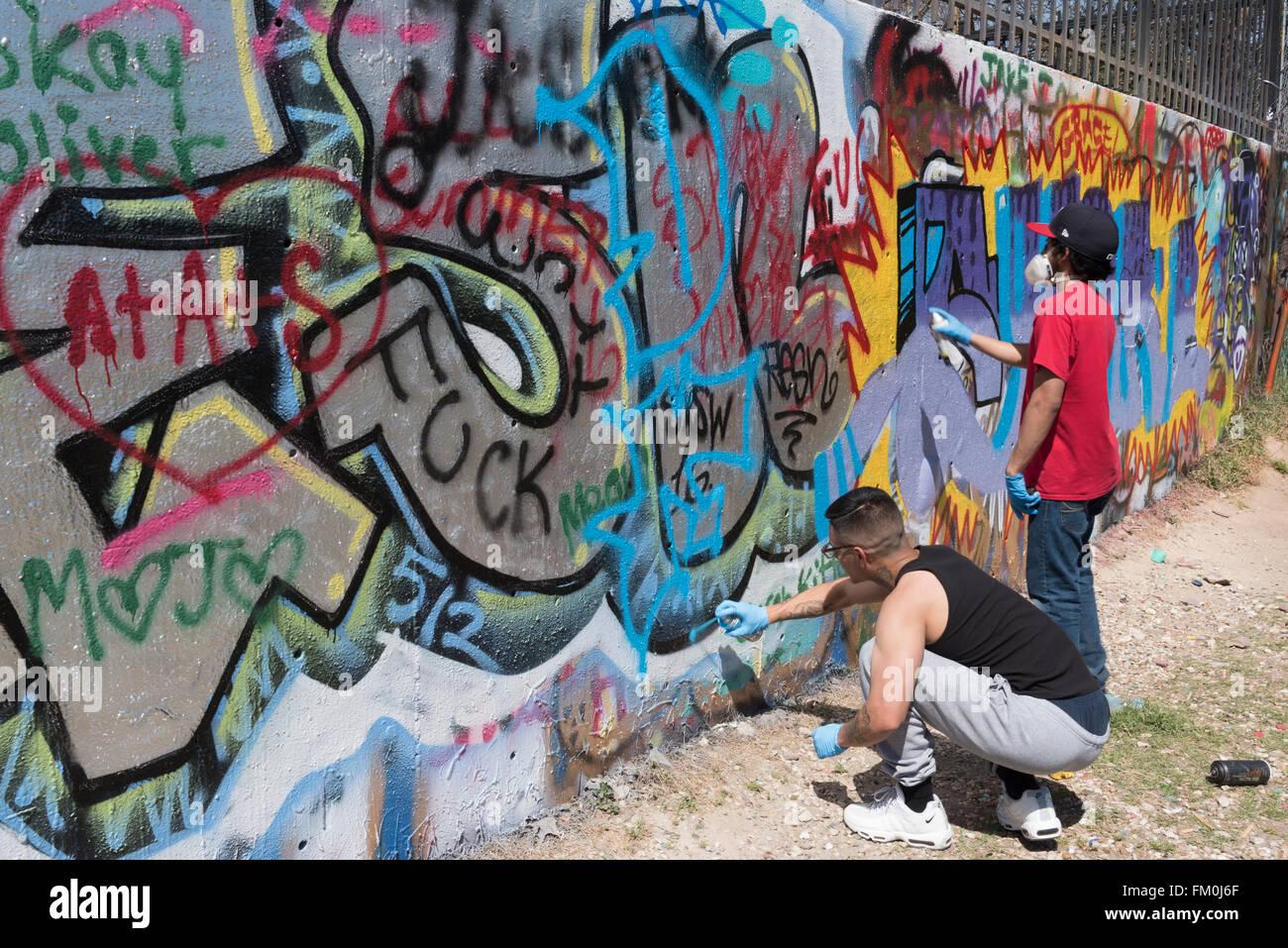 two graffiti artists at austin graffiti park austin texas usa
