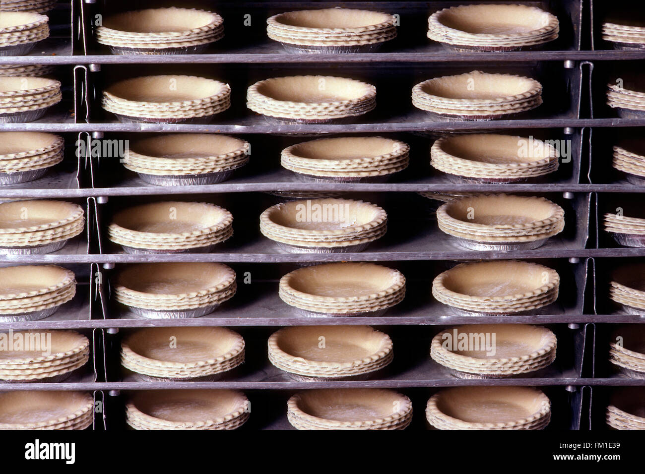 Mrs. Smith's pie crusts on commercial bakery production line - Stock Image